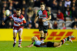Gloucester Full Back (#15) Martyn Thomas chips on as Harlequins Outside Centre (#13) Matt Hopper comes in for the tackle during the second half of the match - Photo mandatory by-line: Rogan Thomson/JMP - Tel: Mobile: 07966 386802 03/11/2012 - SPORT - RUGBY - Twickenham Stoop - London. Harlequins v Gloucester - Aviva Premiership