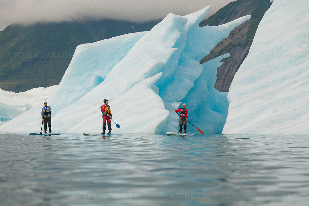 SUP paddling the lagoon near Bear Glacier. Photo © Robert Zaleski / rzcreative.com<br /> —<br /> To license this image contact: robert@rzcreative.com