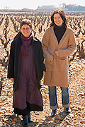 Helene Chouvet, owner, and, right, Agathe Lagarde, maitre de chai winemaker, in the vineyard at Domaine Fontavin, Chateauneuf-du-Pape, Vaucluse, Rhone, Provence, France