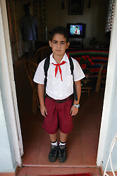 Schoolboy in uniform about to leave for school  Santa Lucia; Pinar Province; Cuba,