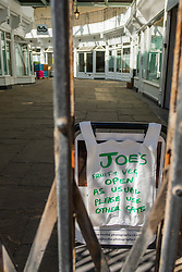 """20 April 2020 Rotherham South Yorkshire - Week 5 of the UK emergency measures to combat the Coronavirus Covid-19 Pandemic.  A sign lets shoppers know """"Joes Fruit & Veg open as usual"""" in the Old Town Hall shopping arcade<br /> <br /> 20 April 2020<br /> <br /> www.pauldaviddrabble.co.uk<br /> All Images Copyright Paul David Drabble - <br /> All rights Reserved - <br /> Moral Rights Asserted -"""