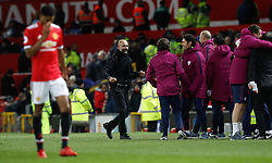 Manchester City manager Pep Guardiola celebrates after the final whistle of the Premier League match at Old Trafford, Manchester.
