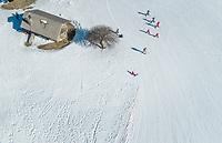 Aerial view of people exercising before skiing at ski resort at Mount Erymanthos, Greece