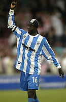 Photo Aidan Ellis, Digitalsport<br /> NORWAY ONLY<br /> <br /> Lincoln City v Huddersfield Town.<br /> Third Divison Play Off Semi Final 1st leg.<br /> 15/05/2004.<br /> Huddersfield's Efetobore Sodje celebrates with the fans at the end of the game