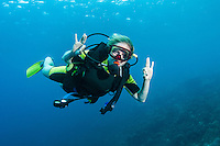 A diver gives the 'okay' sign for the camera, St. Lucia.