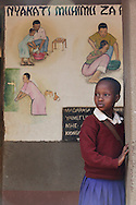 A student at Qaru Lambo primary school waits for class to begin in front of a mural on the importance of hand washing and proper sanitation in Karatu, Tanzania on Thursday, September 27, 2012.  Qaru Lambo primary school students were taught about the importance of hand washing for disease prevention and received hand washing stations and rehabilitated latrines. Several murals were painted around the school to provide students with visual reminders of the lessons they'd learned. Courtesy of Sara A. Fajardo/Catholic Relief ServicesGPS coordinates S3 31.990  E35 39.108