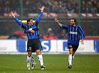 Milano 21/2/2004<br />Milan Inter<br />L'esultanza di Stankovic, Gonzalez e Zanetti dopo il vantaggio dell'Inter.<br />Dejan Stankovic, Kili Gonzalez (back) and Cristiano Zanetti celebrate goal of 1-0 for Inter.<br />Foto Andrea Staccioli Graffiti