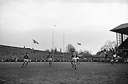 Keogh kicks first score of the match, penalty goal, ..Irish Rugby Football Union, Ireland v Wales, Five Nations, Landsdowne Road, Dublin, Ireland, Saturday 7th March, 1964,.7.3.1964, 7.3.1964,..Referee- A C Luff, Rugby Football Union, ..Score- Ireland 6 - 15 Wales, ..Irish Team, ..F S Keogh, Wearing  Number 15 Irish jersey, Full Back, Bective Rangers Rugby Football Club, Dublin, Ireland,  ..P J Casey, Wearing number 14 Irish jersey, Right Wing, University College Dublin Rugby Football Club, Dublin, Ireland, .. M K Flynn, Wearing number 13 Irish jersey, Right Centre, Wanderers Rugby Football Club, Dublin, Ireland, ..J C Walsh,  Wearing number 12 Irish jersey, Left Centre, University college Cork Rugby Football Club, Cork, Ireland,..K J Houston, Wearing number 11 Irish jersey, Left Wing, Queens University Rugby Football Club, Belfast, Northern Ireland,..C M H Gibson, Wearing number 10 Irish jersey, Stand Off, Cambridge University Rugby Football Club, Cambridge, England, and, N.I.F.C, Rugby Football Club, Belfast, Northern Ireland, ..J C Kelly, Wearing number 9 Irish jersey, Scrum Half, University College Dublin Rugby Football Club, Dublin, Ireland,..P J Dwyer, Wearing number 1 Irish jersey, Forward, University College Dublin Rugby Football Club, Dublin, Ireland, ..P Lane, Wearing number 2 Irish jersey, Forward, Old Crescent Rugby Football Club, Limerick, Ireland, ..T A Moroney, Wearing number 3 Irish jersey, Forward, University College Dublin Rugby Football Club, Dublin, Ireland, ..W A Mulcahy, Wearing number 4 Irish jersey, Captain of the Irish team, Forward, Bective Rangers Rugby Football Club, Dublin, Ireland,  ..M W Leahy,  Wearing number 5 Irish jersey, Forward, University college Cork Rugby Football Club, Cork, Ireland,..E P McGuire,  Wearing number 6 Irish jersey, Forward, University college Galway Rugby Football Club, Galway, Ireland,..M G Culliton, Wearing number 8 Irish jersey, Forward, Wanderers Rugby Football Club, Dublin, Ireland, ..N A Murphy, Wearing nu