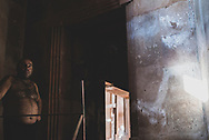 A construction workers stands inside what will become the Holy Mother of God Cathedral (Surb Astvatsamor Hovanu Cathedral), an Armenian Apostolic Church in the city of Stepanakert, Nagorno-Karabakh Republic. The Cathedral was consecrated in 2019, three years after this picture was taken on September 22, 2016.
