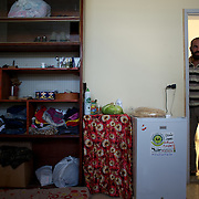 Sohaib Akkari, a Syrian refugee, at the entrance of the improvised room he shares with his family at a refugee center in Wadi Khaled, Lebanon.