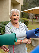 A senior woman socializing after yoga class