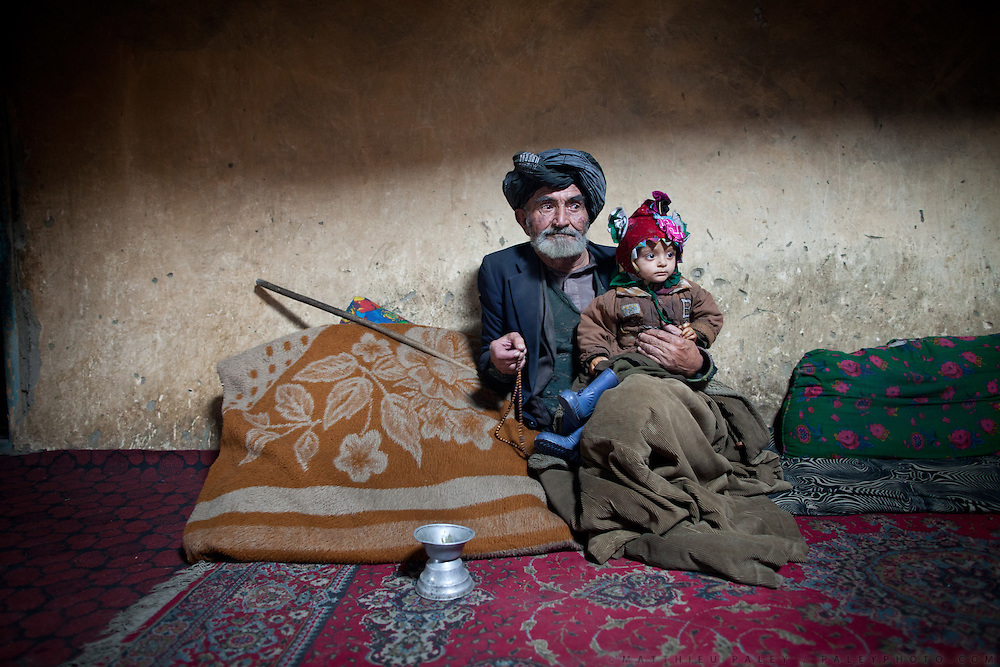 An old Wakhi man and his grand son..In Goz Khun village...Driving down from Sarhad village, end of the road in the Wakhan corridor, to Ishkashim town, on the Tajikistan border.
