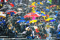Fans weather the first half storm as Grant High School plays St. Mary's High School in the SAC-Joaquin Section Division II Championship game at Sacramento State, Friday December 5, 2014.<br /> Brian Baer/Special to the Bee