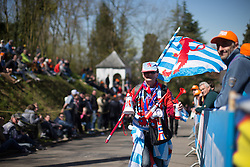 A colorfully dressed fan walks up on the Mur de Huy during the Flèche Wallonne Femmes - a 137km road race from starting and finishing in Huy on April 20, 2016 in Liege, Belgium.