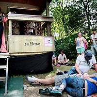 Nederland, Landgraaf, 14 juni 2015<br /> Publiekkan lekker relaxen en naar muziek kijken en luisteren in de Garden of love tijdens het Pinkpopfestival.<br /> <br /> <br /> Foto: Jean-Pierre Jans
