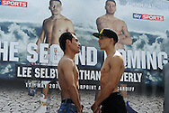 Lee Selby of Wales ® at weigh in preparing for his fight against Romulu Koasicha of Mexico (l) . Weigh in for the 'second coming' 17th May Cardiff boxing show in Queen Street, Cardiff, South Wales on Friday 16th May 2014.<br /> pic by Andrew Orchard, Andrew Orchard sports photography.