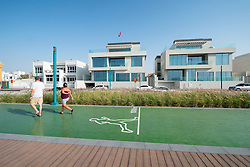 New redeveloped jogging and walking track and luxury villas along beach at Umm Suqueim  in Dubai United Arab Emirates