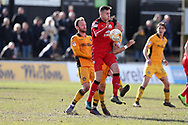 Conor Henderson of Crawley Town gets to the ball ahead of Sean Rigg of Newport county (l). . EFL Skybet football league two match, Newport county v Crawley Town at Rodney Parade in Newport, South Wales on Saturday 1st April 2017.<br /> pic by Andrew Orchard, Andrew Orchard sports photography.