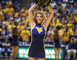 Jan 19, 2019; Morgantown, WV, USA; A West Virginia Mountaineers dancer performs during the second half against the Kansas Jayhawks at WVU Coliseum. Mandatory Credit: Ben Queen-USA TODAY Sports