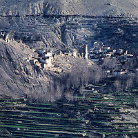 Barley fields and an ancient village in the Himalayan rainshadow near Muktinath, north of Annapurna in Nepal
