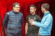 Luton Town caretaker manager, Mick Harford chats with Alan Sheehan (#44) of Luton Town FC (centre) and the Luton Town press officer, before the EFL Sky Bet League 1 match between Sunderland AFC and Luton Town at the Stadium Of Light, Sunderland, England on 12 January 2019.