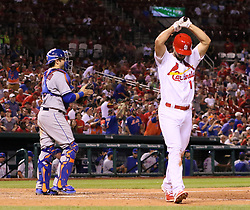 July 7, 2017 - St Louis, MO, USA - The St. Louis Cardinals' Paul DeJong returns to the dugout after striking out to end the game against the New York Mets on Friday July 7, 2017, at Busch Stadium in St. Louis. The Mets won, 6-5. (Credit Image: © Chris Lee/TNS via ZUMA Wire)