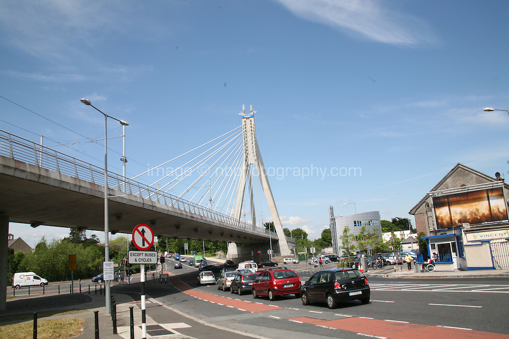 The Luas tram passes through Dundrum, over the large cable-stayed William Dargan Bridge, at Taney Cross. Dundrum in Dublin Ireland