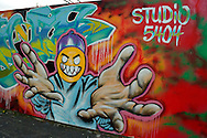 Massapequa, New York, USA. September 18, 2014. Studio 5404 Art Space opening reception for art show Taking it to the Street features new works by emerging and up-and-coming local and New York artists. Outdoor art included Wallgraffiti by Sonic Bad, Panic Rodriguez, Crazy Eddie and Mat Hatter. Studio 5404 is on the South Shore of Long Island.
