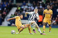 James McClean of West Bromwich Albion © tackles Mousa Dembele of Tottenham Hotspur (l). Premier league match, West Bromwich Albion v Tottenham Hotspur at the Hawthorns stadium in West Bromwich, Midlands on Saturday 15th October 2016. pic by Andrew Orchard, Andrew Orchard sports photography.