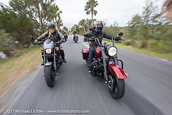 Iron Lilly Leticia Cline on a new 2017 Harley-Davidson 750 Street Rod alongside custom bike builder Jesse Rooke on a 2017 Harley-Davidson Road King Special as they ride through Tomoka State Park during Daytona Beach Bike Week. FL. USA. Tuesday, March 14, 2017. Photography ©2017 Michael Lichter.