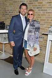 ZOE JORDAN and her husband STEVE ASPINALL at a summer drinks party hosted by Bec Astley Clarke at the Serpentine Sackler Gallery, Hyde Park, London on 17th June 2014.