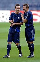 Photo: Richard Lane.<br /> Chelsea training session. UEFA Champions League. 30/10/2006. <br /> John Terry and Andrei Shevchenko share a joke.