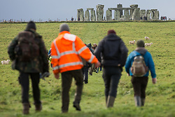 Over a hundred people, including local residents, climate and land justice activists and pagans, arrive to take part in a Mass Trespass at Stonehenge on 5th December 2020 in Salisbury, United Kingdom. The trespass was organised in protest against the approval by Transport Secretary Grant Shapps of a £1.7bn project for a two-mile tunnel beneath the World Heritage Site and a further eight miles of dual carriageway for the A303, as well as the government's £27bn Road Investment Strategy 2 (RIS2).