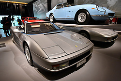 """© Licensed to London News Pictures. 14/11/2017. London, UK.  (L to R) A Ferrari Testarossa Spyder, 1986, commissioned by Gianni Agnelli to commemorate his 20th anniversary as Chairman of Fiat, and a Ferrari 275 GTB/4, 1967.  Preview of """"Ferrari: Under the Skin"""", an exhibition at the Design Museum to mark the 70th anniversary of Ferrari.  Over GBP140m worth of Ferraris are on display from private collections including Michael Schumacher's 2000 F1 winning car.  The exhibition runs 15 November to 15 April 2018.  Photo credit: Stephen Chung/LNP"""