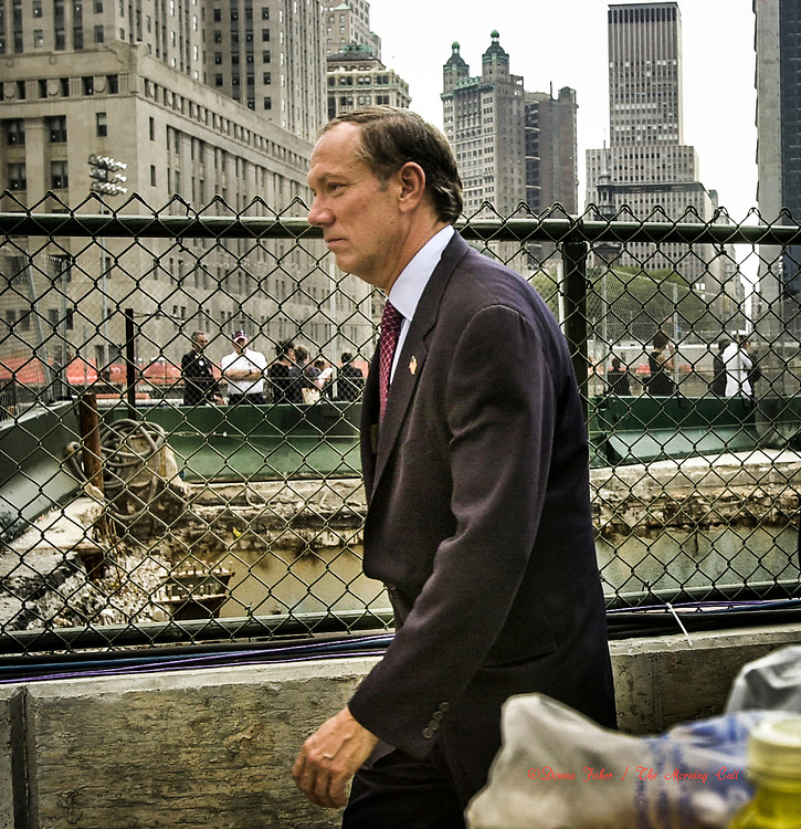 New York Governor George Pataki at Ground Zero. 9/11 scenes in New York City on September 11, 2001 and at subsequent events relating to the terror attacks on the World Trade Centers in New York City, the Pentagon in Arlington, Virginia and at Shanksville, Pa..