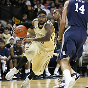 Central Florida guard Marcus Jordan (5) drives toward Arsalan Kazemi (14) of Iran, during the first half of  a Conference USA NCAA basketball game between the Rice Owls and the Central Florida Knights at the UCF Arena on January 22, 2011 in Orlando, Florida. Rice won the game 57-50 and extended the Knights losing streak to 4 games.  (AP Photo/Alex Menendez)