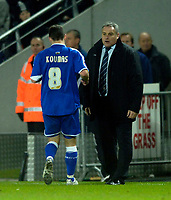 Photo: Jed Wee.<br />Hull City v Cardiff City. Coca Cola Championship.<br />03/12/2005.<br />Cardiff manager Dave Jones (R) delivers instructions to Jason Koumas.