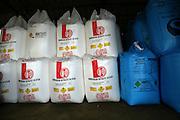 Ammonium nitrate Nitram fertiliser bags stored in a barn