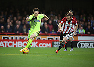 Hudderfield Town striker Joe Lolley powering away from Brentford midfielder Alan Judge during the Sky Bet Championship match between Brentford and Huddersfield Town at Griffin Park, London, England on 19 December 2015. Photo by Matthew Redman.