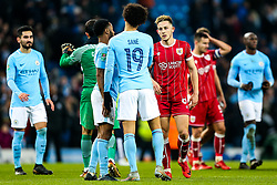 Josh Brownhill of Bristol City congratulates Raheem Sterling and Leroy Sane of Manchester City after Manchester City win 2-1 in added time - Rogan/JMP - 09/01/2018 - Etihad Stadium - Manchester, England - Manchester City v Bristol City - Carabao Cup Semi Final First Leg.