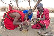 Maasais making fire. From Amboseli, Kenya.