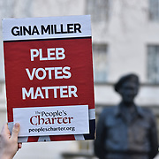 A small group Pro-Brexit supporter holding placards holds a rally opposite Downing Street on 14th January 2018, London, UK