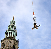 Bungee jumping at the Grote Markt in Groningen, in the background the Martinitoren.