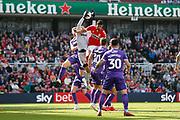 Stoke City goalkeeper Adam Federici (32) spills a cross under pressure from Middlesbrough forward Ashley Fletcher (18)  during the EFL Sky Bet Championship match between Middlesbrough and Stoke City at the Riverside Stadium, Middlesbrough, England on 19 April 2019.