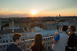 People watch the sun setting over the city of St Petersburg, Russia, on the eve of England's 3rd/4th place World Cup match against Belgium.