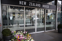 London, UK. 16th March, 2019. Floral tributes outside the New Zealand High Commission as thousands of people march through central London on the March Against Racism demonstration on UN Anti-Racism Day against a background of increasing far-right activism around the world and a terror attack yesterday on two mosques in New Zealand by a far-right extremist which left 49 people dead and another 48 injured.