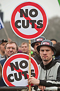 Protestors watch the speeches during the rally at the TUC March for the Alternative 26 March 2011, Hyde Park London.