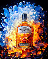 Jack Daniels Whiskey on ice cubes and hot glowing coals.
