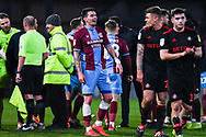 Adam Hammier of Scunthorpe United (47) chats with Max Power of Sunderland (27) at the full time whistle after the EFL Sky Bet League 1 match between Scunthorpe United and Sunderland at Glanford Park, Scunthorpe, England on 19 January 2019.