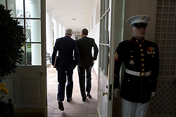 President Barack Obama walks on the Colonnade of the White House with Secretary of State John Kerry following a working lunch with President Ashraf Ghani of Afghanistan, March 24, 2015. (Official White House Photo by Pete Souza)<br /> <br /> This official White House photograph is being made available only for publication by news organizations and/or for personal use printing by the subject(s) of the photograph. The photograph may not be manipulated in any way and may not be used in commercial or political materials, advertisements, emails, products, promotions that in any way suggests approval or endorsement of the President, the First Family, or the White House.